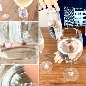 Eine Bildcollage ist zu sehen: links vier Bilder untereinander. Das oberste: Wasser wird in ein Sektglas eingeschenkt. Die weiteren sind Nahaufnahmen vom Wasser im Glas - Wellen sind zu sehen. Rechts: ein großes Bild, auf dem einige Gläser gezeigt sind. Eines wird von einer Hand berührt. Die Hand soll sich im Kreis um den Glasrand bewegen.