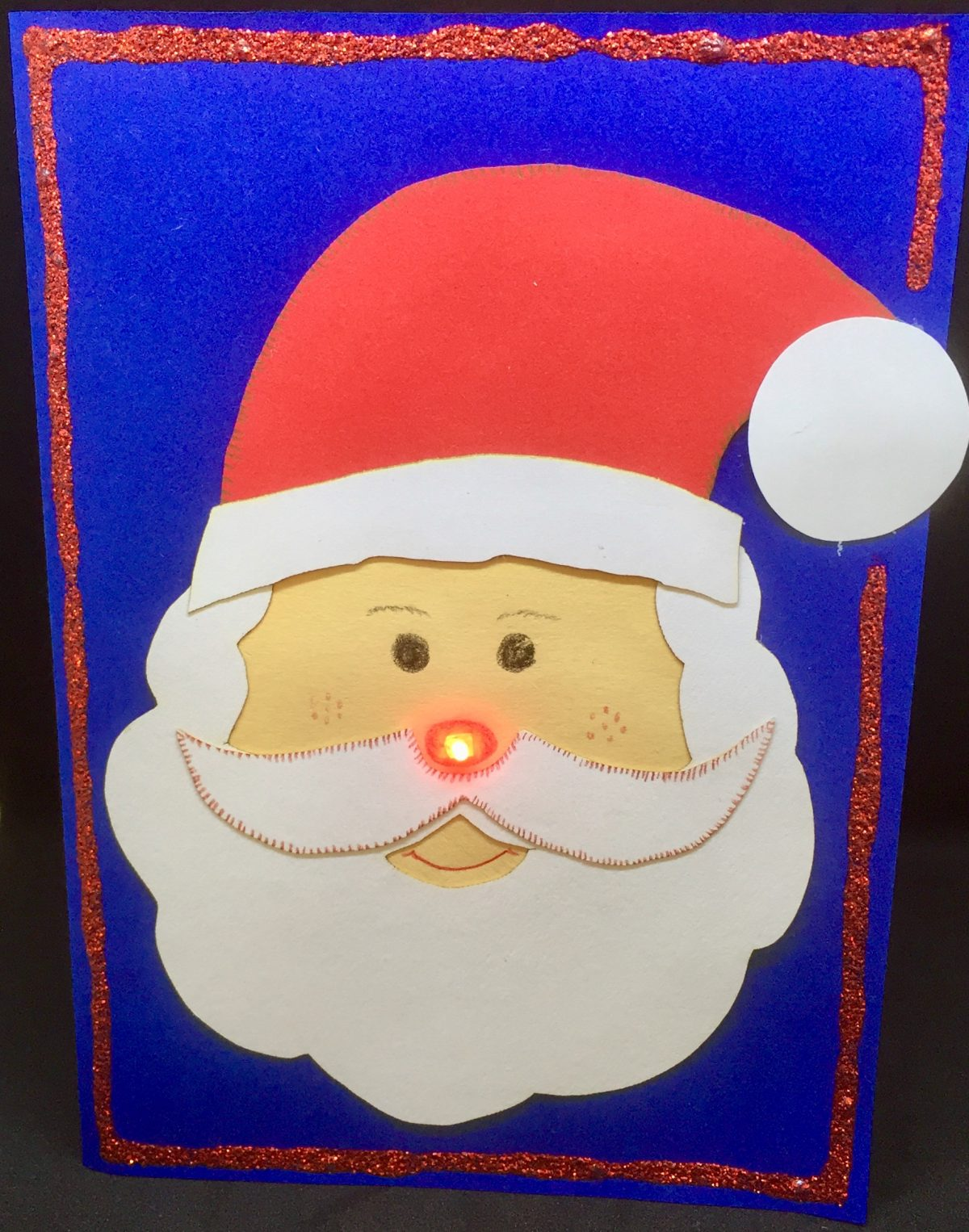 http://blog.forschenfuerkinder.de/2017/12/15/leuchtende-weihnachtskarten/ Weihnachtskarte Weihnachtsmann LED Stromkreis