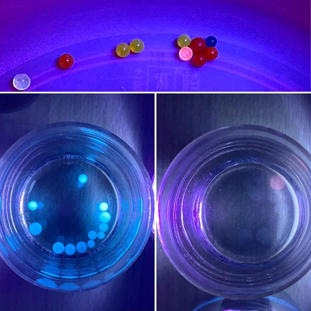 UV-Licht lässt Wasserperlen leuchten.